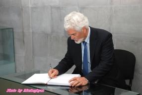 Kyriacos Triantaphyllides signs Genocide commemoration book